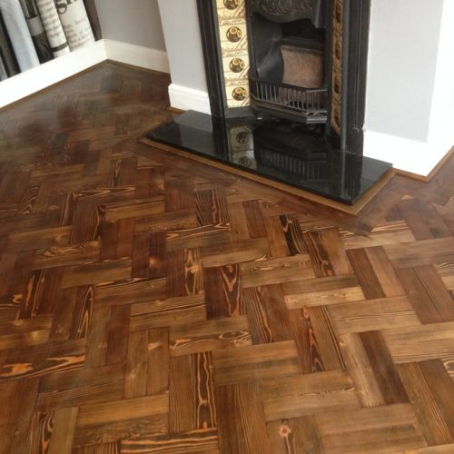 traditional herringbone pattern with 2 brick bond border stained medium oak