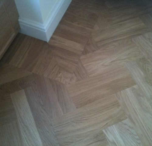 double herringbone with soldier border in prime oak