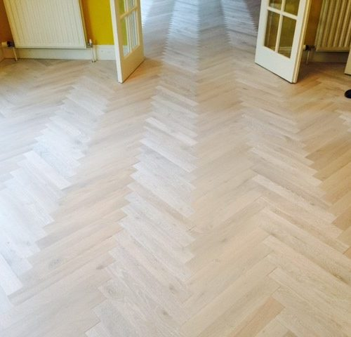 factory pre finished lined oak herringbone pattern